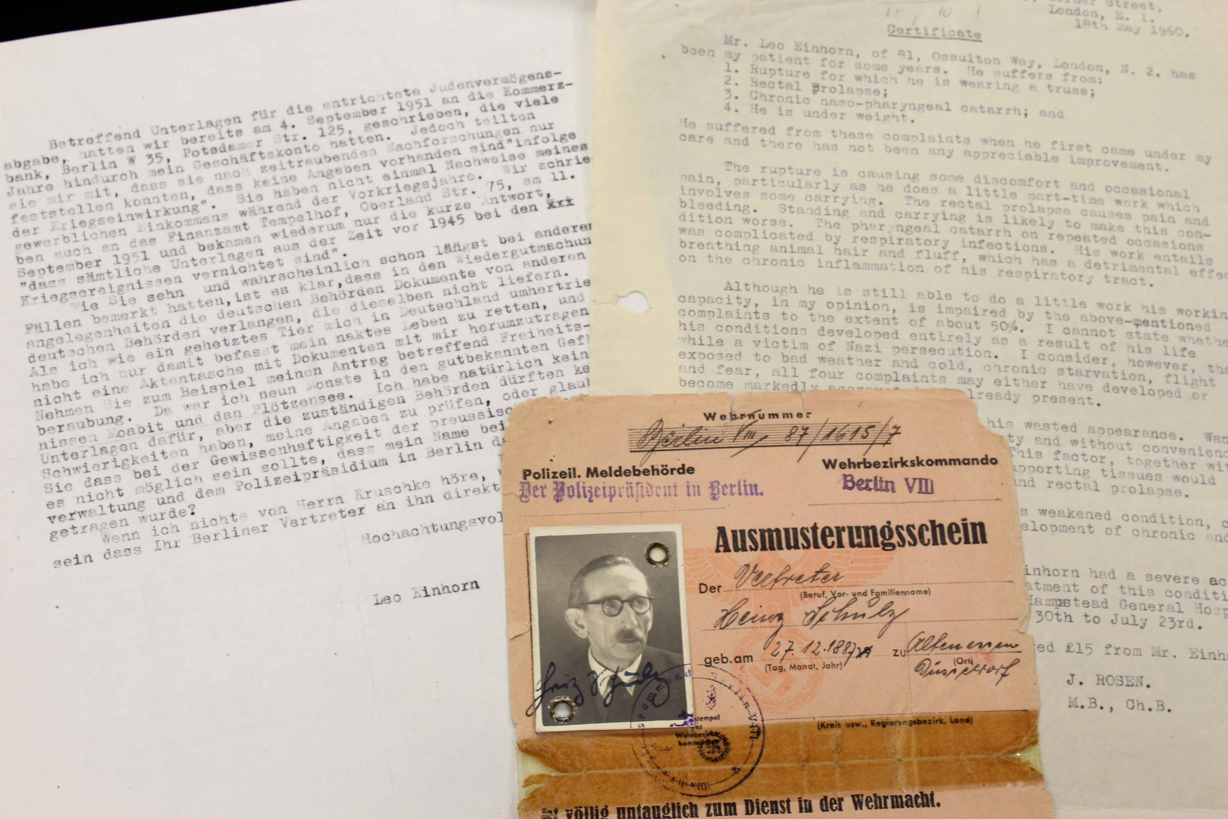 Two typewritten letters and a formal document with black and white passport photo