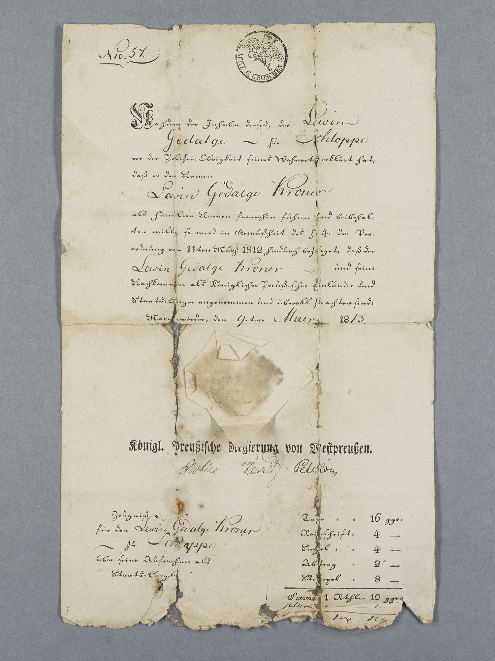 Mostly handwritten form with a paper seal, frayed along the edges