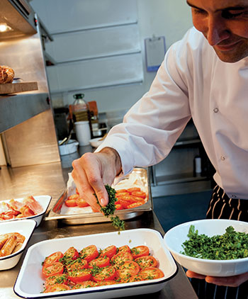 Sous Chef Mark Kipling preparing breakfast in Eat Central's kitchen