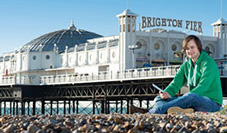 Student in front of Brighton pier