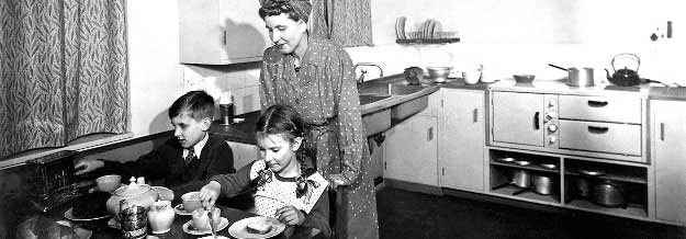 Mother and children in the kitchen - 1940s