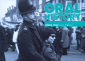Oral History magazine cover - policeman arrsting a woman