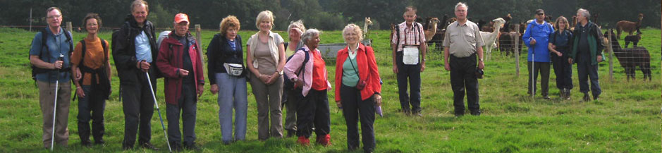 This is a group photograph of the London Blind Ramblers Club with the lamas on an overcast day in East Sussex, taken 2009.