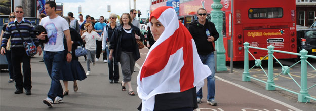 Woman wearing St George's Cross flag