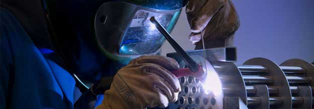 Student in workshop welding