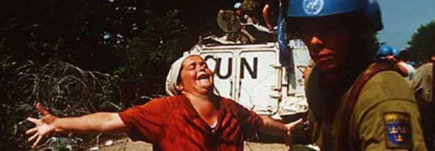 Woman screaming in front of UN vehicle and  soldier