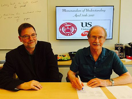 Justin Rosenberg and Phil McMichael at the signing of the MoU, April 2015
