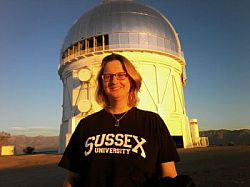 Professor Kathy Romer at the telescope in Chile