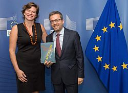 Mariana Mazzucato and Carlos Moedas hold copy of new book Rethinking Capitalism