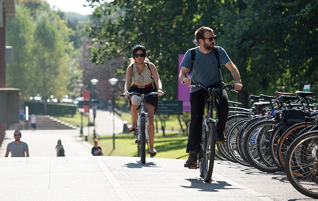 Students cycling on Sussex campus