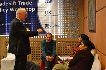 Jim Rollo and Peter Holmes talk to participants in an India-Pakistan workshop in Kathmandu in 2013.