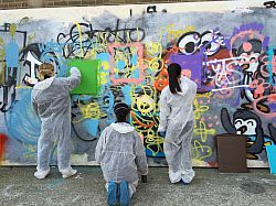 Sussex Law students create art work and paint freely on walls at Sinna One