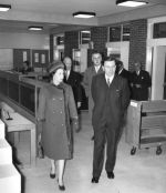 The Queen and Dennis Cox (Librarian) walk around the new Library in 1964