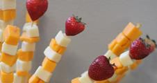 cheese and strawberries on sticks
