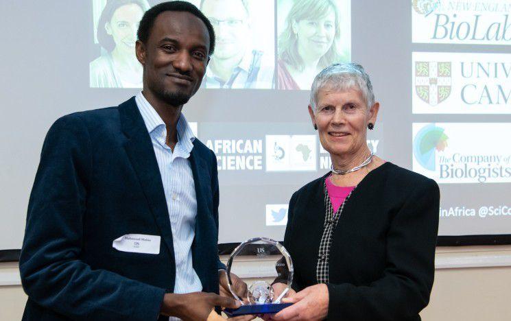 Lady Margaret Kroto presenting Dr Mahmoud Maina with the 2019 Kroto Award for Public Engagement