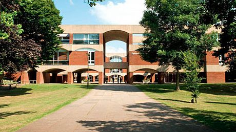 Picture of the entrance of University of Sussex. It is a modernist building using red bricks.