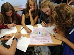 Pupils working on a maths problem at the maths enrichment day on campus in autumn 2012.