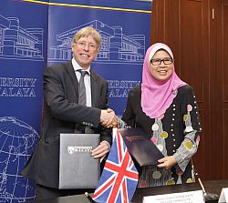 Professor Stephen Shute, Pro-Vice-Chancellor (Planning and Resources) with University of Malaya Associate Vice-Chancellor (International), Professor Kamila Ghazali, following the Memorandum of Understanding signing