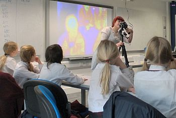 Primary school students learning about heat using a thermal camera