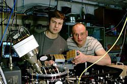 Dr Bjorn Lekitsch (left) and Prof Winfried Hensinger behind a quantum computer prototype at the University of Sussex.