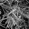 A magnified photograph of asbestos fibres