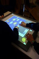 Children using a digital touch tabletop