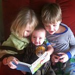Three Siblings Share a Book