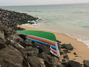 A fishing boat crashed against the seawall near Anchuthengu, a risk the local fishers face during the rough-sea monsoon season