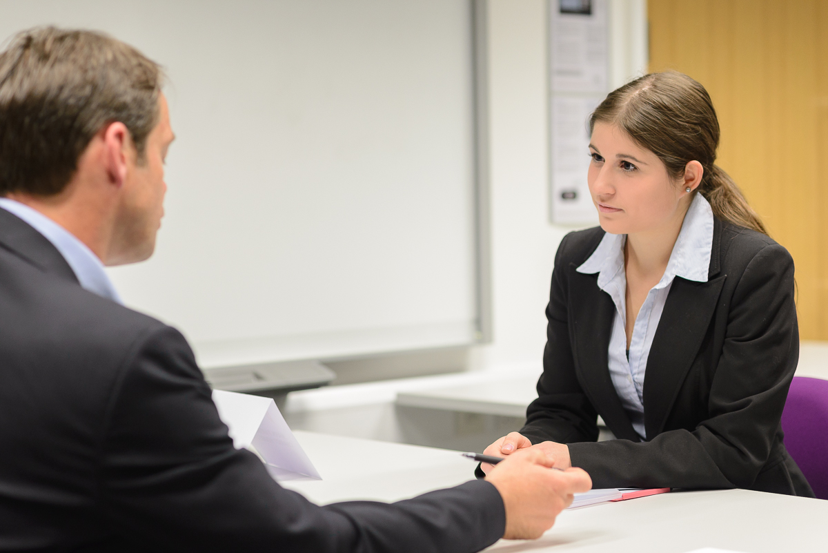A student meets with a representative from a professional membership body
