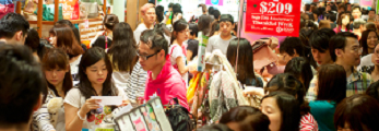 People shop in a market place