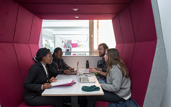 Business students doing group work in one of our study pods in the Jubilee Building