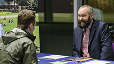 An employer talking to a member of the School of Business, Management and Economics