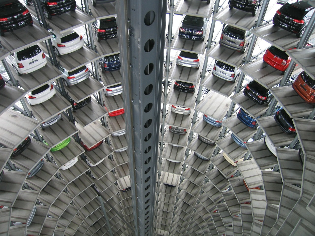 A photo of a large multi-storey car park with many cars