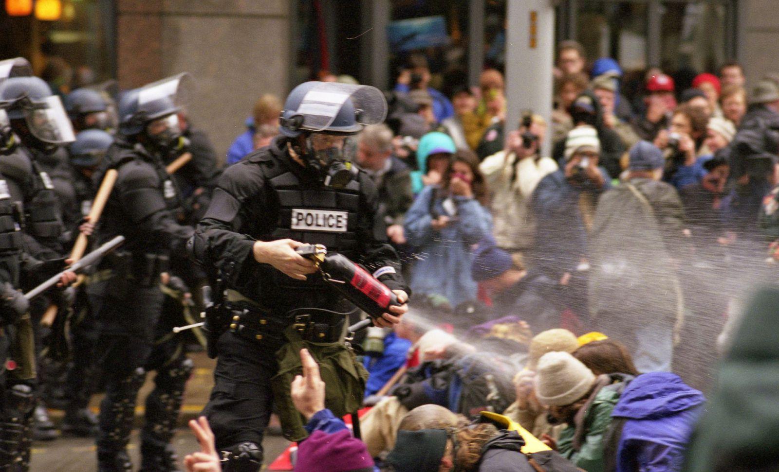 Police pepper spray anti-WTO protesters in Seattle in November 1999