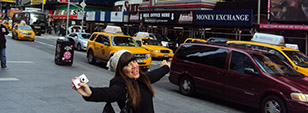A Sussex American Studies student on her year studying abroad in New York, posing in front of yellow cabs