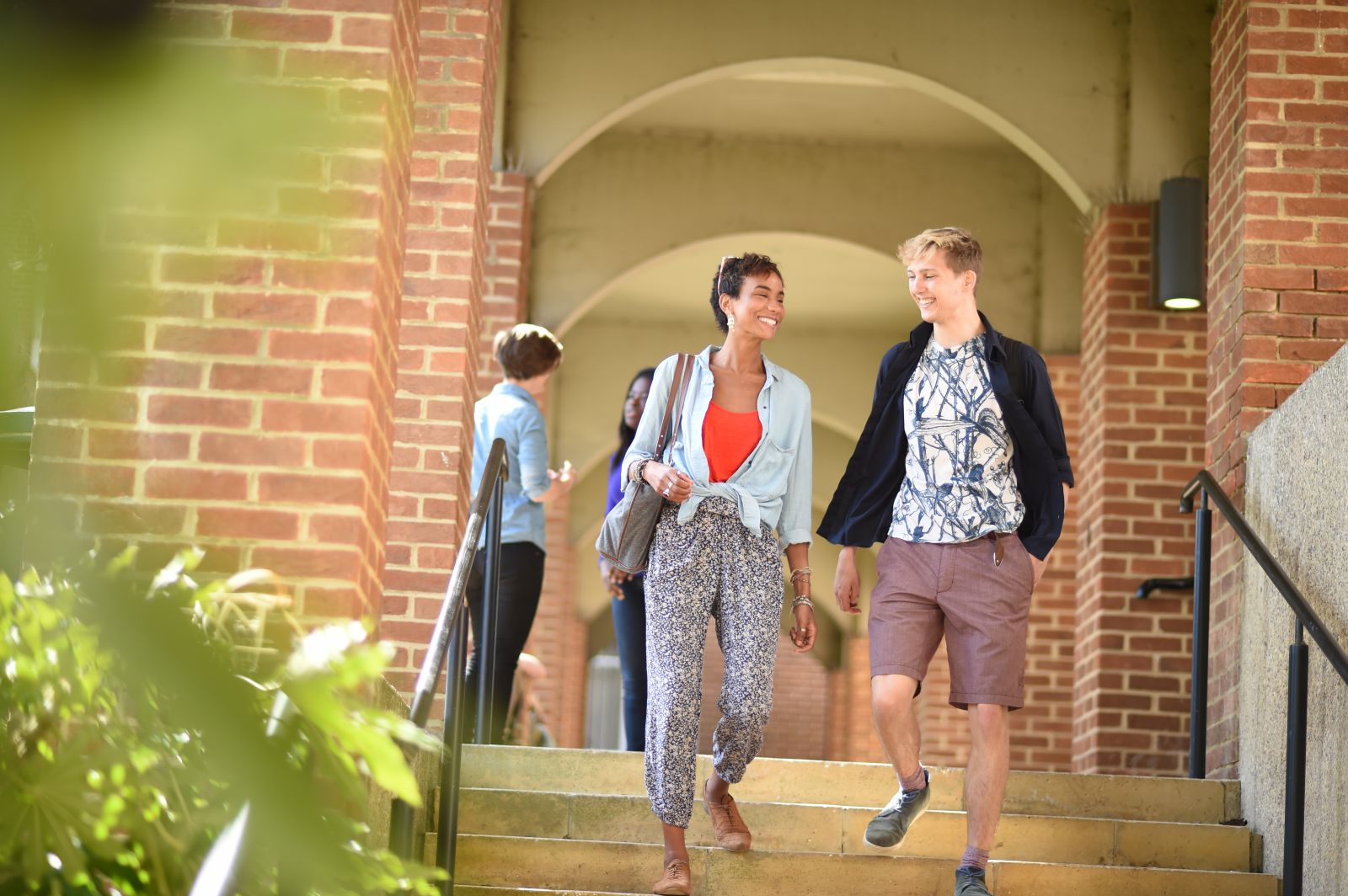 Students walking on campus at the University of Sussex