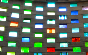 The coloured window panes of the Meeting House letting daylight through