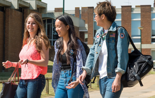 International students walking through the campus at the University of Sussex