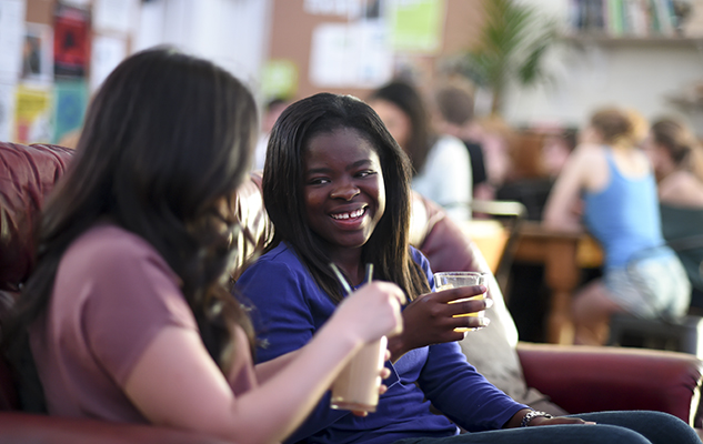Two students talking in a cafe at the University of Sussex