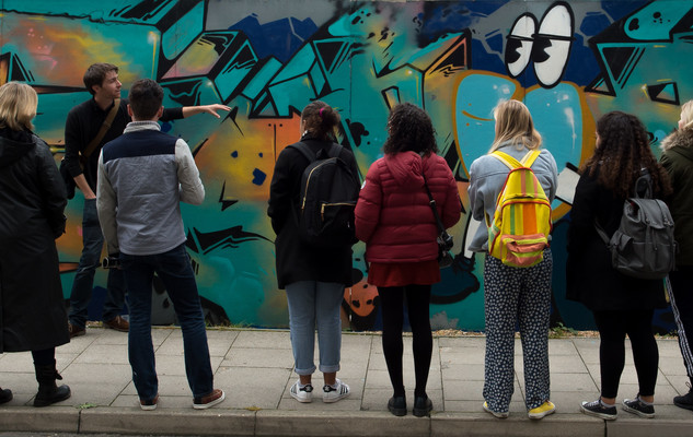 Students studying an art work in Brighton city centre