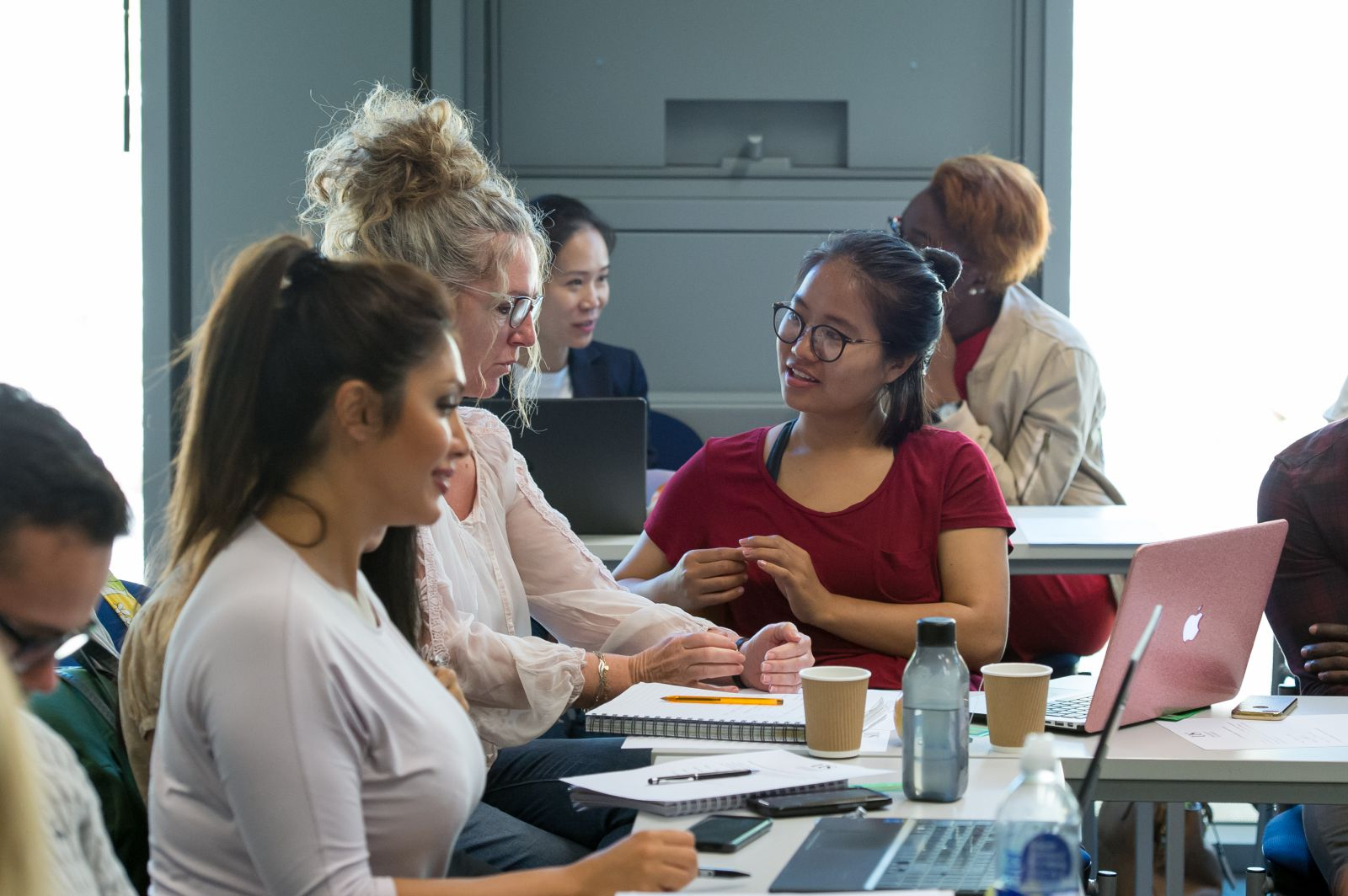 Undergraduate students work together during a seminar in the Jubilee Building, home to the University of Sussex Business School