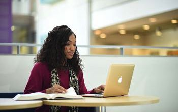 Photo of a student in the Library at the University of Sussex