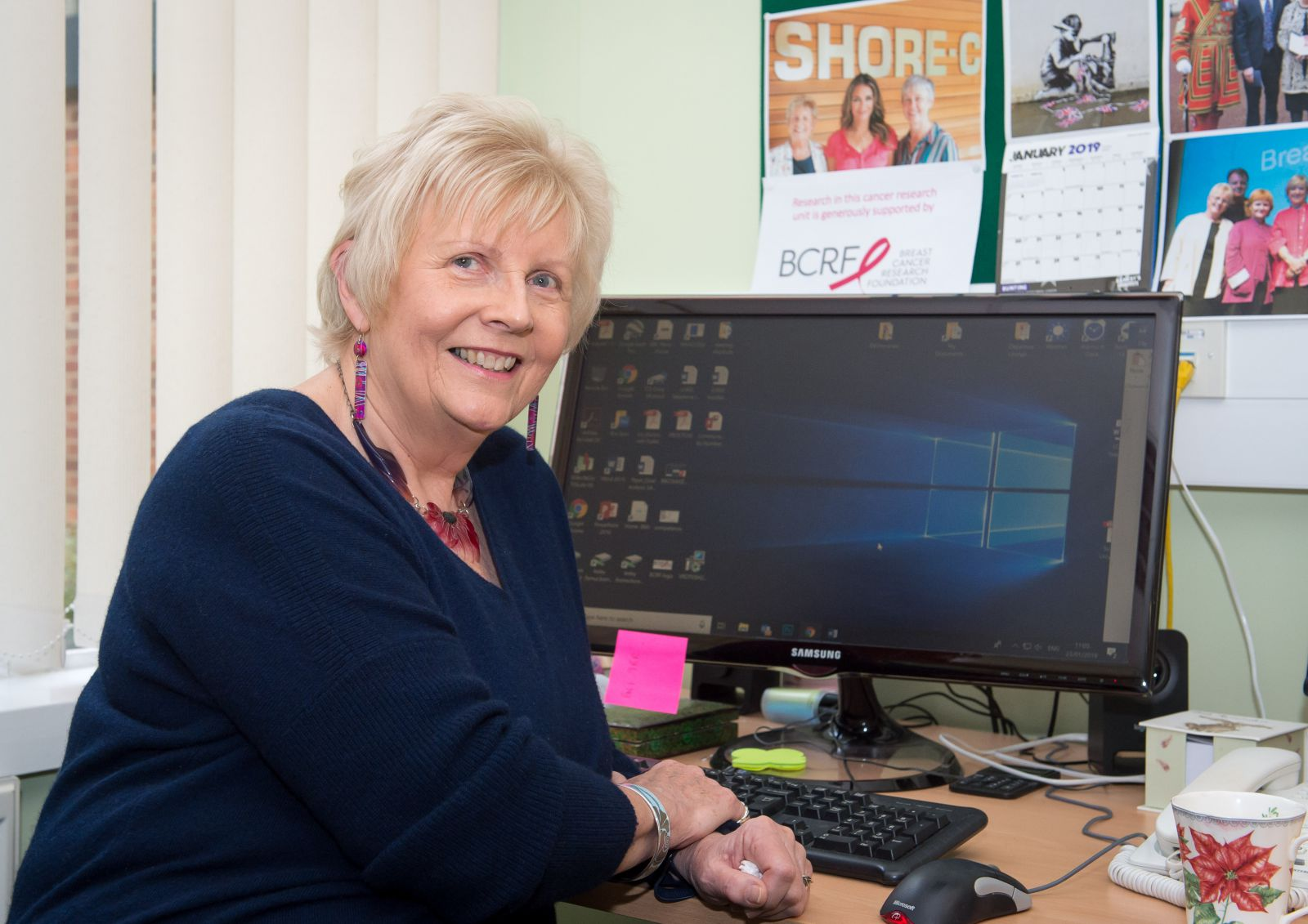 Professor Dame Lesley Fallowfield at her desk