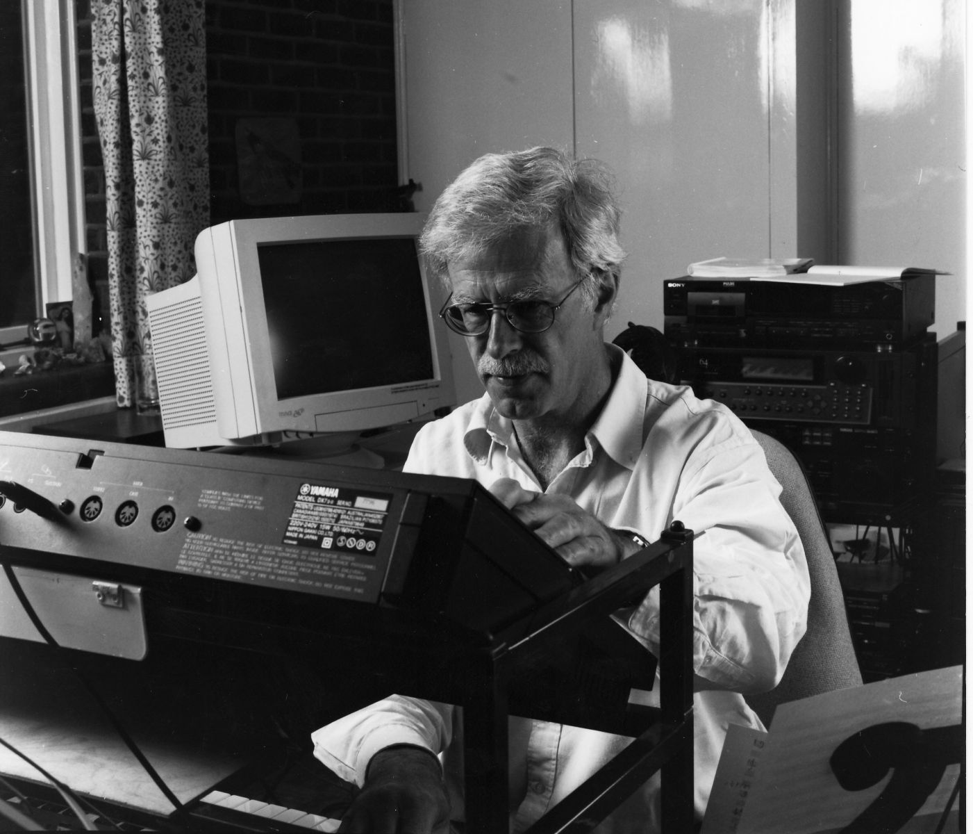 Professor Jonathan Harvey working in his office, sat at a keyboard
