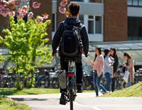 Man cycling on campus