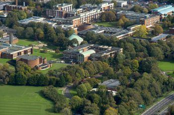 An aerial image showing the University of Sussex campus set among the South Downs National Park