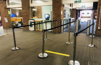 Library entry gates, three queue barriers set up inside the entry gates of Sussex Library