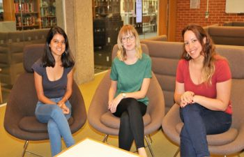 Research hive scholars, Aanchal Vij, Devyn Glass, Louise Elali sitting together in the research hive in Sussex Library