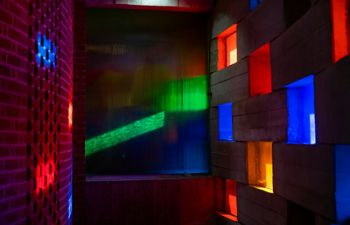 Light coming through the coloured windows of the Meeting House
