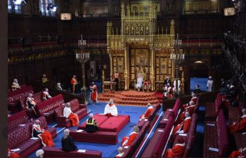An aerial view over the House of Lords while the Queen reads the Government-scripted speech